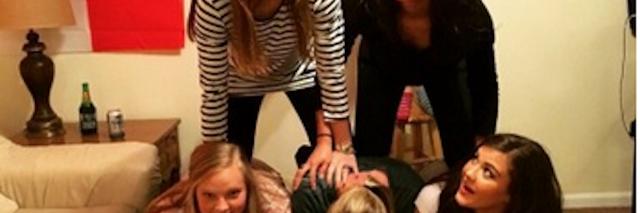 Six female friends making a pyramid
