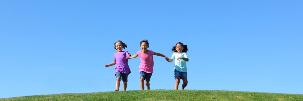 Children running together holding hands