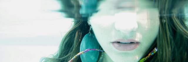 lower half of woman's face underwater
