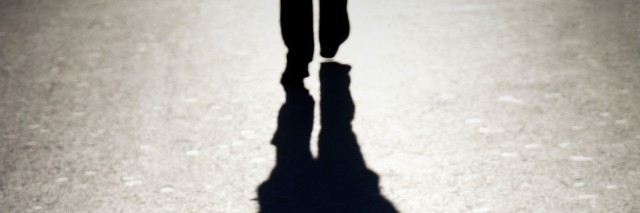 The shadow of a man walking