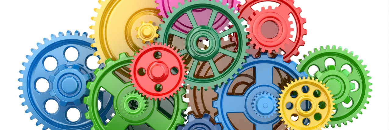 Color gears on white isolated background.