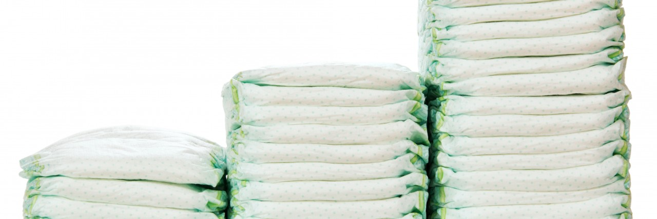 steps of stacks of diapers isolated on white background