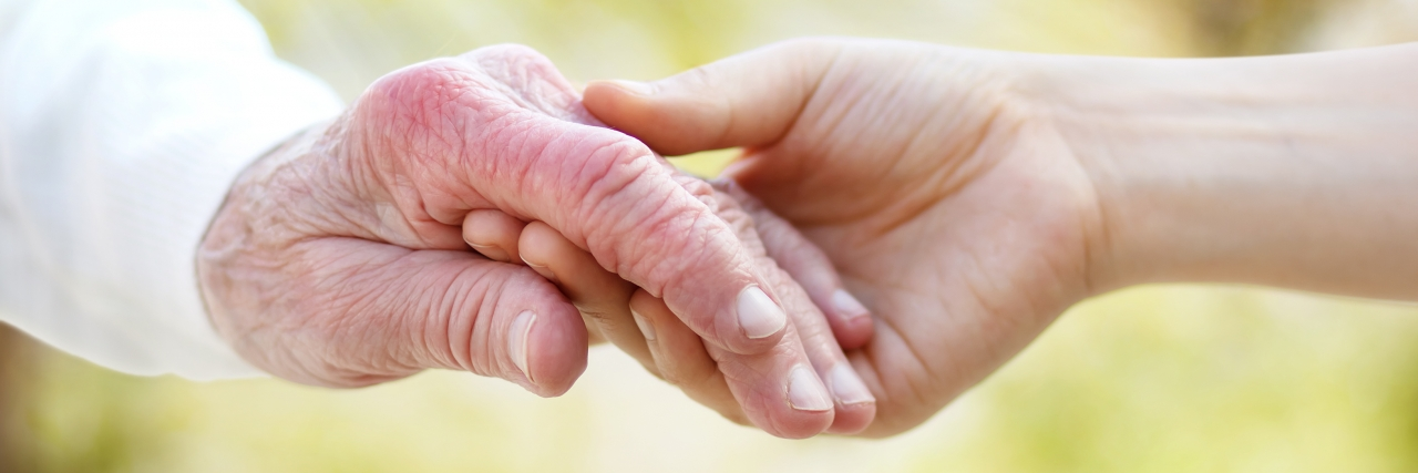 Holding hands with a person with arthritis.