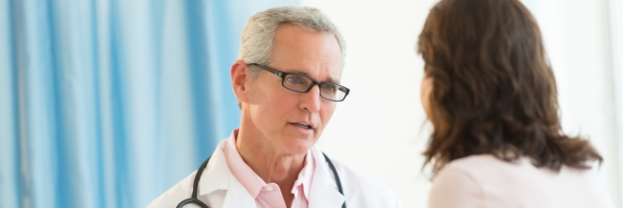 doctor discusses diagnosis with female patient