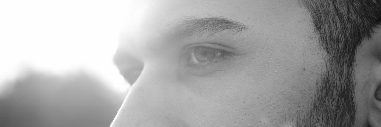 close up of young men, strong sun light