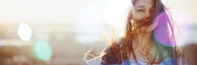 Young Woman Standing in Sunset Light