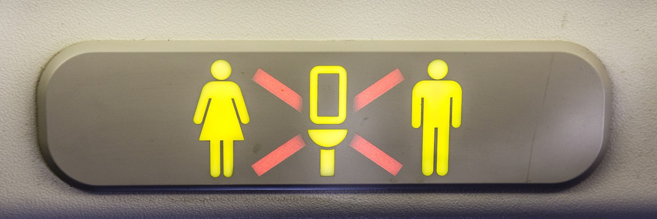 bathroom sign for airplane showing it is occupied