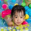 Girl playing in kiddy pool.