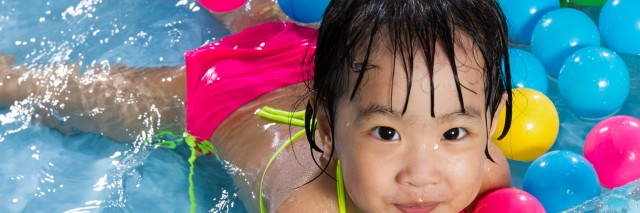 Girl playing in kiddy pool.