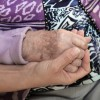 Daughter holding her mother`s hand