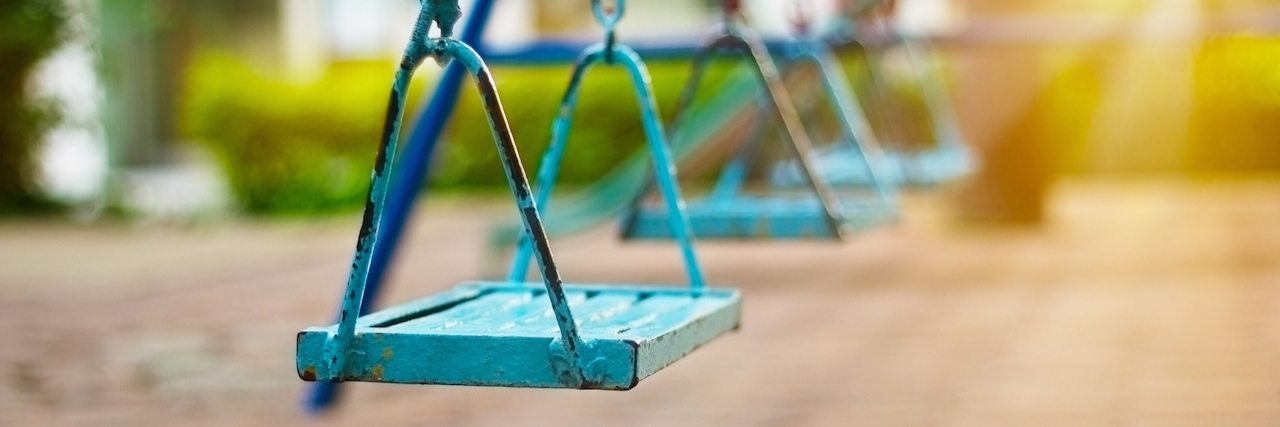 Closeup of swings in the park of morning