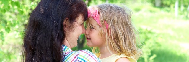 mom playing with daughter outside