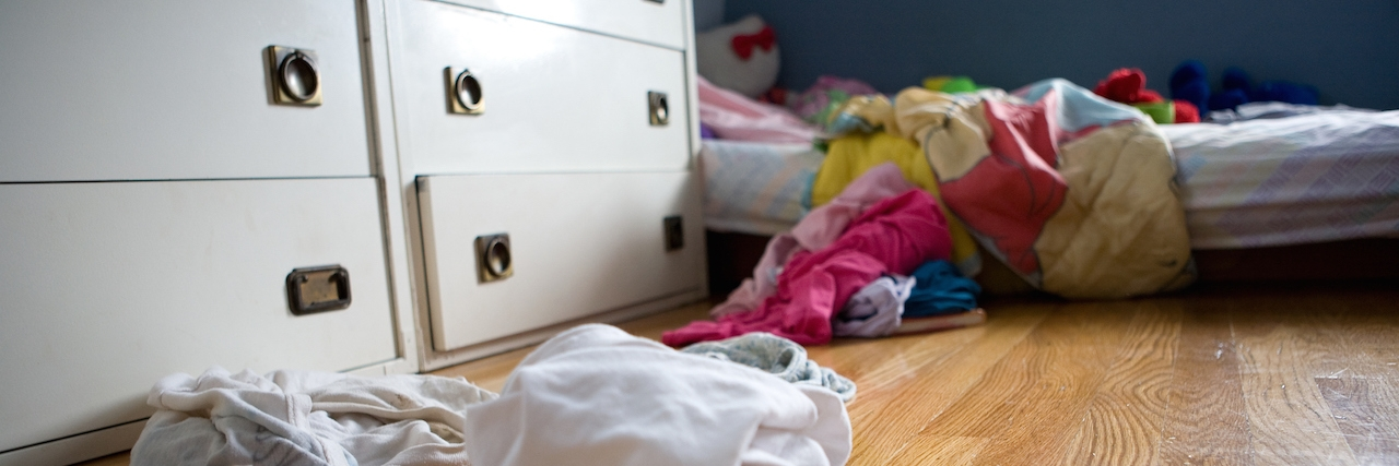 Child's bedroom with dirty laundry on floor