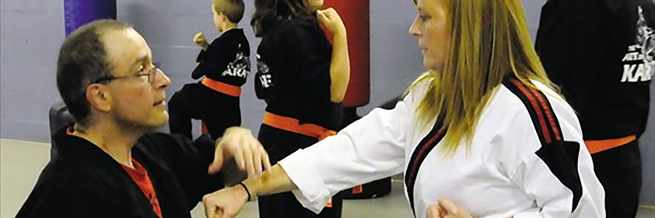Paul Brailer with a martial arts student.