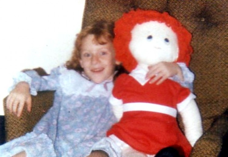 Young Denise and her Annie doll.
