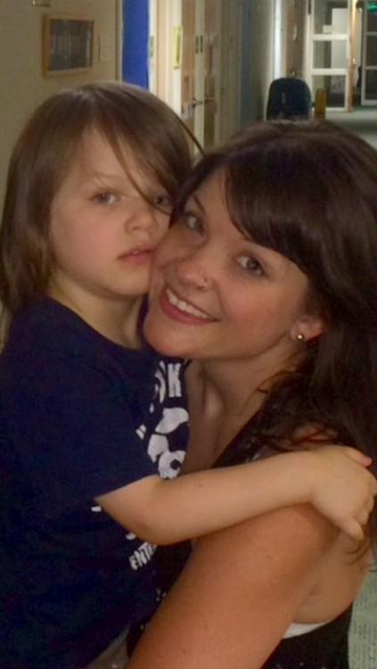 Jen holding her son