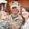 Samantha, her husband in his army uniform, and her son.