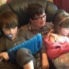 mom reading to her two autistic children on ipads