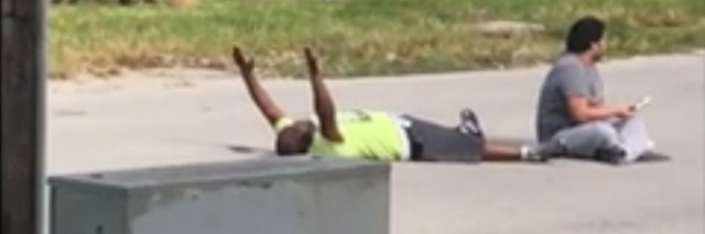 In video provided by Charles Kinsey's attorney, Kinsey lies on the ground with his hands up.