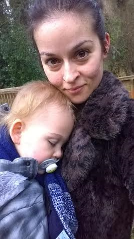 woman hugging toddler son who has head on her shoulder
