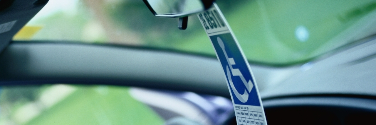 disabled parking pass on car mirror