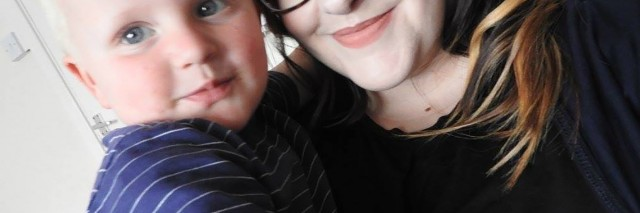 Sarah hugging her nephew Kaine.