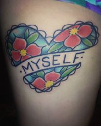 "A heart shaped tattoo with the word ""Myself"" written in the middle"
