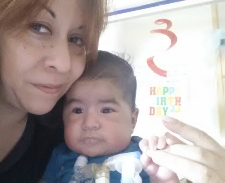 Melissa with her son who has SMA on his birthday