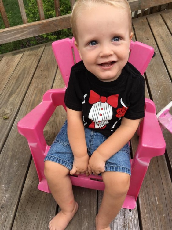 Son with SMA smiling in chair