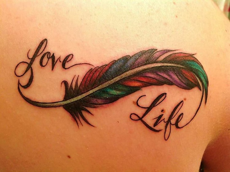 "tattoo of a feather reads"" love life"""