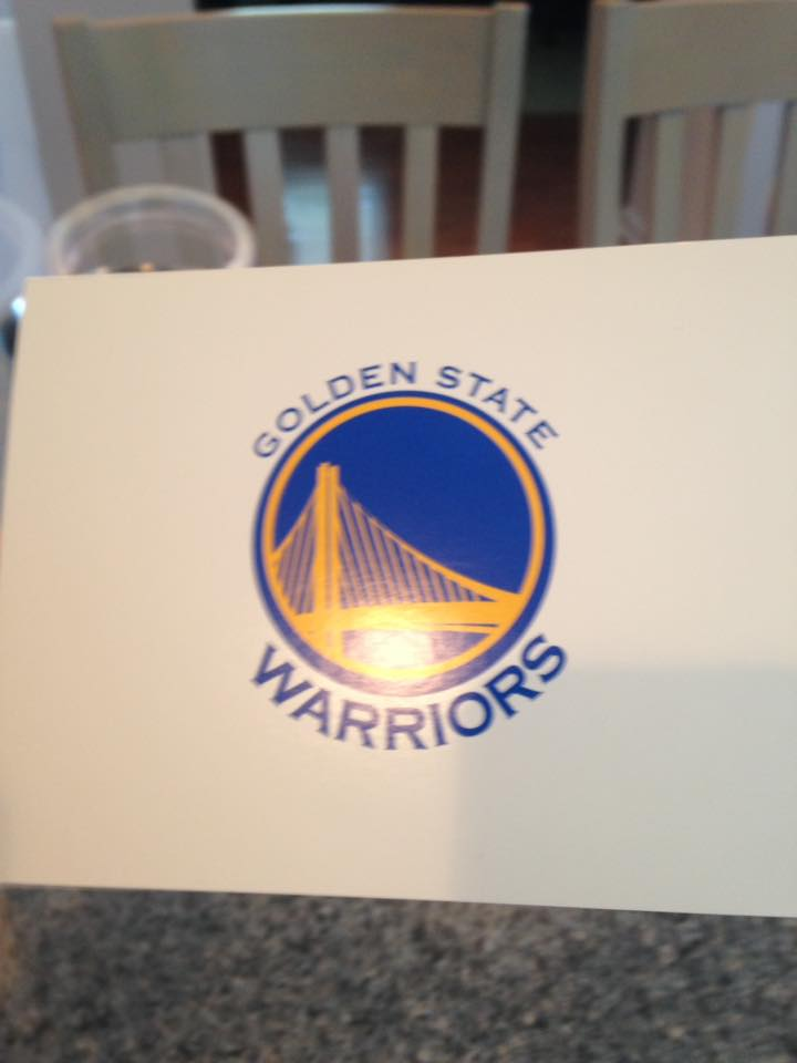 White card with Golden State Warriors logo (a yellow bridge over a blue background) on it