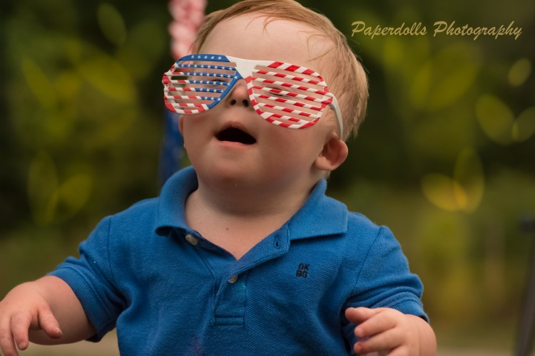 Young boy wearing patriotic sunglasses