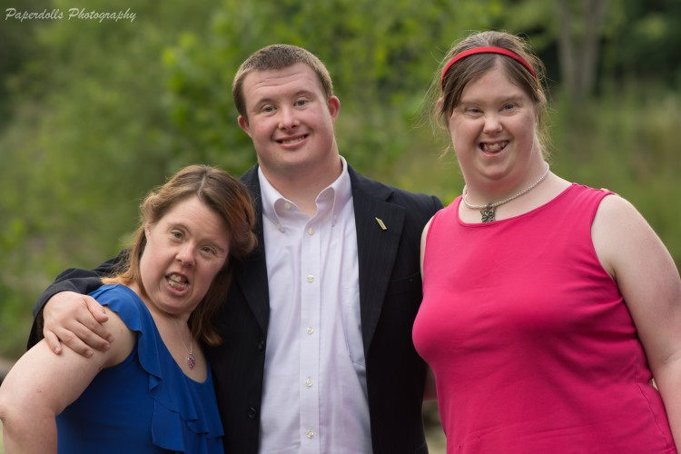 Three adults with special needs