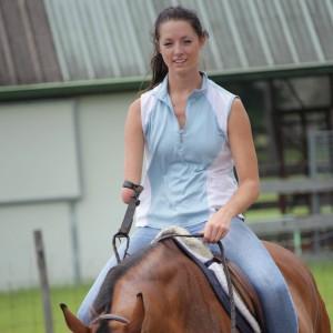 Ashley Sherman riding a horse