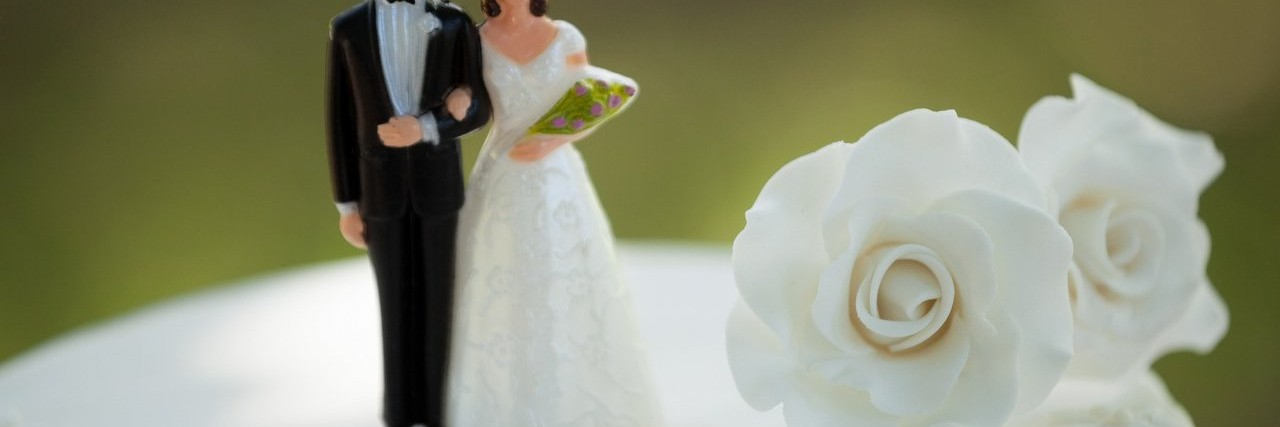 figurine couple on wedding cake