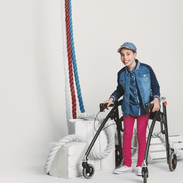 Girl with assistive device modeling Runway of Dreams clothing