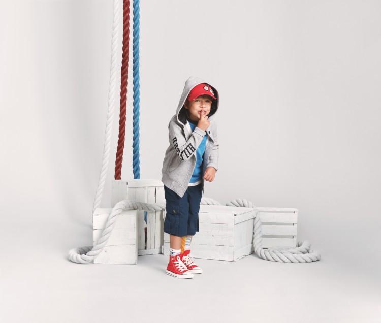 Little boy modeling Tommy Hilfiger clothes