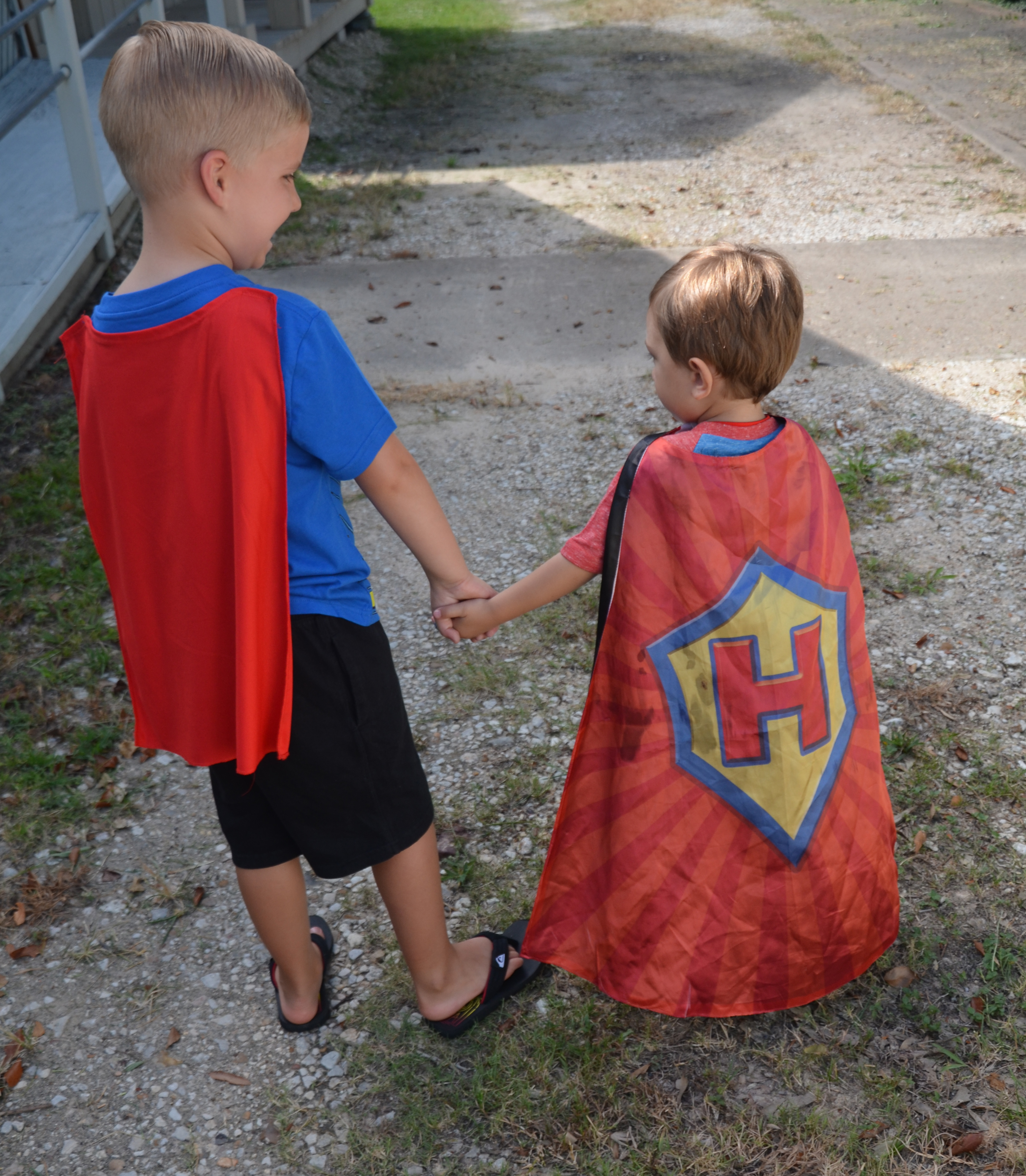two boys in capes