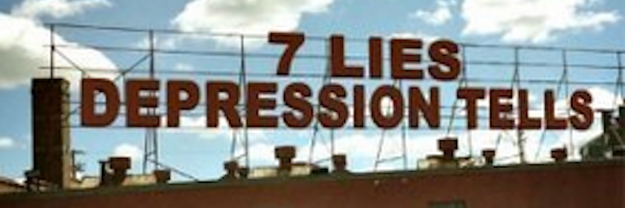 """The words """"7 Lies Depression Tells"""" on a building"""