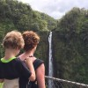mom with son on her back looking at a waterfall