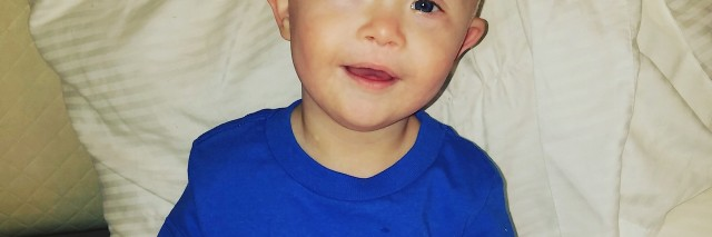 The author's son wearing a blue shirt