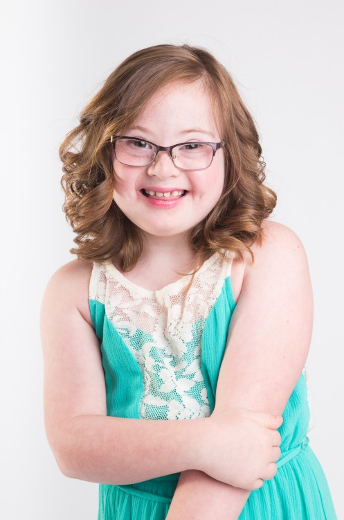 Girl with Down syndrome modeling