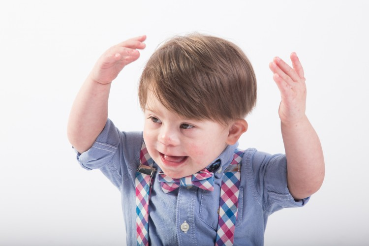 Little boy with Down syndrome modeling