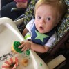 baby with down syndrome in a high chair