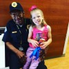 hospital security guard with little girl on lap