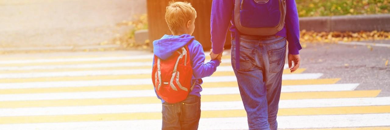 parent walking son to school