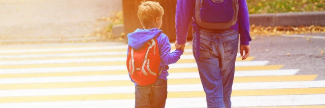 parent walking son to school