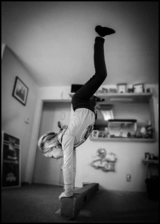 Photograph of Kayleigh doing a handstand