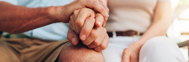 couple sitting together and holding hands