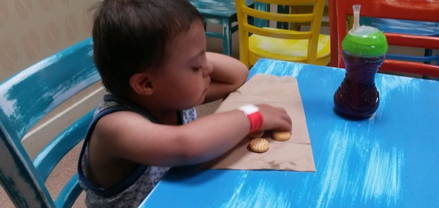 boy with down syndrome eating crackers